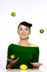 girl juggling fruit
